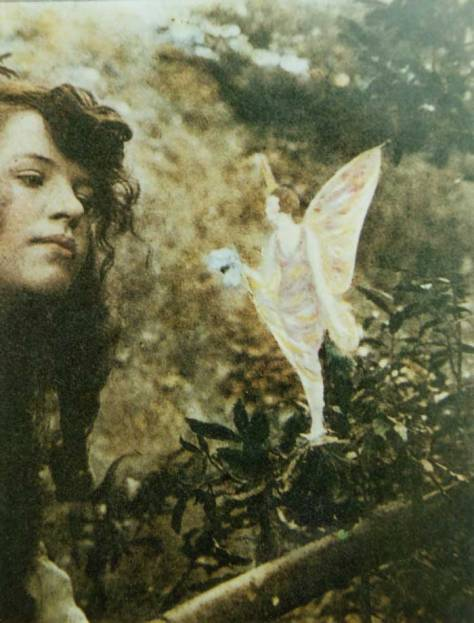 "Elsie Wright as photographed by her cousin Frances Griffiths in 1920 with a ""fairy"""